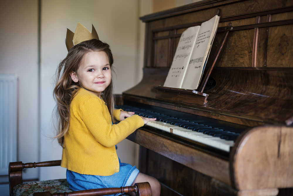 Girl Playing Piano Concept